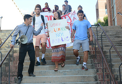 Members of the Students for a Democratic Society march together protesting the Board of Governor's decision against Gender-Neutral housing earlier this year. They marched from the pit to the General Administration building, where the Board of Governors was holding its monthly meeting.