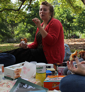 "Cary Simpson, a senior English major from Chapel Hill enjoys a picnic in the arboretum Sunday morning with members of her poetry class. Simpson said they were having this picnic ""because we love each other and are in a thesis class and we like to hang out."" Shown but not fully pictured are Mallory Hawkins (closest) and Chandler Bachelor."