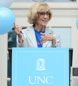 UNC School of Journalism Dean Susan King speaks from the steps of Carroll Hall to begin the day-long event.