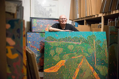 "Marvin Saltzman poses with his artwork in his studio, located in Chapel Hill on July 22nd. A small portion of Saltzman's thousands of pieces is currently on display in the Eno Gallery in Hillsboro.   ""I draw from nature, and then I paint about nature."" ""Bad teachers train, good teachers open doors."""