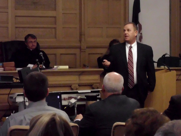Iowa prosecutor Andy Prosser uses slides to remind the jury of evidence against Seth Techel during closing arguments. Two people in the gallery walked out when the defense mentioned honoring victim Lisa Techel as one reason to find the defendant not guilty.