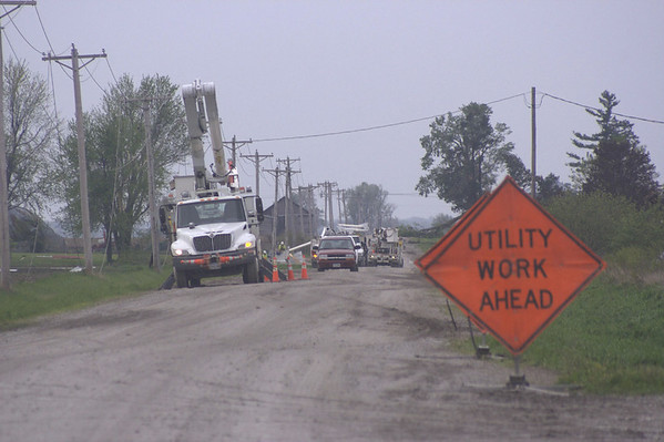 Matt Milner/CNHI for the Courier<br /> Downed powerlines, like these just outside Hedrick, kept crews busy Sunday. Some customers kept power during the overnight storms, but lost it in the heavy winds during the day.