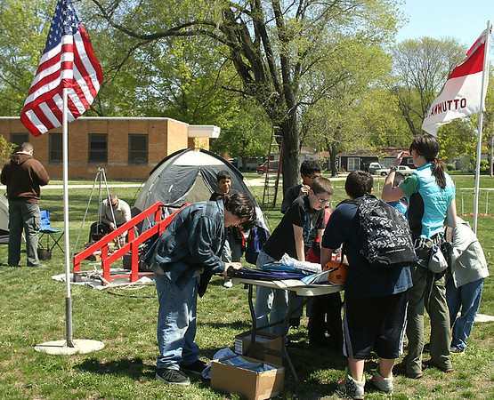 Mark Newman/The Courier<br /> A campfire, canoes and cobbler drew the attention of students interested in signing up for the Boy Scouts of America. Scout leaders hosted a recruitment drive Wednesday at Evans Middle School.