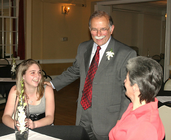 Tom Lazio greets Bethanne and Jenny Johnstone of Ottumwa, two of the many guests at his retirement party Sunday. Lazio spent 45 years at American Home Findings, a community service agency.<br /> Mark Newman