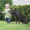 "Mark Newman/The Courier<br /> Ready for Adventure<br /> Gabrial Crane, 15 months, and his pal ""Mocha"" find plenty of fun right in their own yard on Ottumwa's south side Thursday afternoon.  Today, temps are expected to remain in the 50s, with mostly sunny skies."