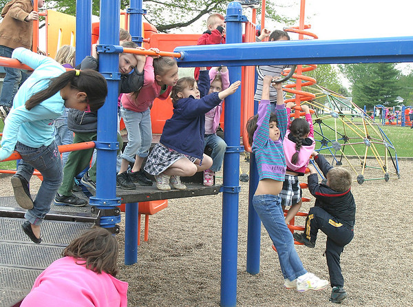 Mark Newman/The Courier<br /> Kindergarten students at Douma Elementary School get rid of some of their excess energy after lunch Monday.