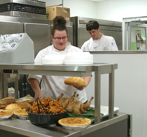 Mark Newman/The Courier<br /> Student chef Anne Buckman and her fellow cooks get read to show off some locally grown food Saturday at the Cultivating Opportunity local food meeting at Indian Hills Community College. Even the bread was made from locally purchased  wheat.