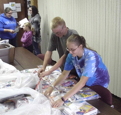 Catie Vaux, 16, right and Trevor Pilcher, 15, were two of the volunteers helping sort school supplies for families at the Wapello County Resource Center. The center, part of Southern Iowa Economic Development Agency on Main Street in Ottumwa, saw 180 requests for supplies last year, and may pass 200 this year.