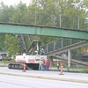 Mark Newman/The Courier<br /> Crews began work Monday on the walking bridge which goes over the highway to Eisenhower Elementary School despite the lack of answers on who is responsible for paying. The bridge was made unsafe when struck by a truck, but should be ready in time for school.