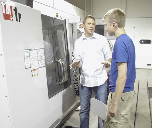 With the fall semester rapidly approaching, students are getting ready for college. Blake Leshen of Albia, right, toured the Advanced Technology building Tuesday evening with Tyler Wyngarden of Indian Hills Community College. <br /> Mark Newman/The Courier
