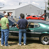 Frank Everman, 18 of Corydon, left, enjoyes talking with visitors Sunday about his 1972 Mach One at the Ford Powered Show at the Davis County Fairgrounds. The Iowa Missouri Ford Club hosts said that for this, their 26th show, there were around 120 vehicles on display.