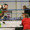 TNA Impact official Brian Hebner, right, gets a close up look at wrestlers in Ottumwa Saturday during a Gut Check tryout at Bridge View Center. Fighters were't just at a tryout; they were receiving coaching, too.
