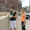 Katrina Woodley of Oskaloosa and Kayla Shelton of Ft. Madison put the finishing touches on a newly painted wall in the Hydro parking lot Friday. They were two of the six Ottumwa Job Corps students who volunteered for the project.