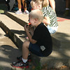 A last taste of summer<br /> Austin McKim, 5, starts his first year at Agassiz Elementary School in a shady spot with a slice of watermelon alongside his big sister, JoAnna, 9, who is entering fourth grade. Several elementary schools had open houses for students and parents on Monday.