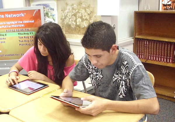 Ignacio Patlan and Esmeralda Rodriguez work on their class assignments Thursday at Ottumwa High School with iPads. Students at OHS are expected to learn how to use technology — and how to use it responsibly.