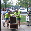 """TWO COL OR LESS<br /> They may look happy, but the """"Move Crew"""" members at IHCC, including Faith Schulz, left and Rachel Cobler, were working hard to get students moved in on campus Sunday."""