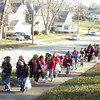 Students from Wilson Elementary School walked all the way to the Lord's Cupboard to deliver the food they collected. The food is distributed to needy families locally. <br /> Mark Newman/Courier Staff Photographer