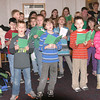 Seton Students Sing<br /> Mark Newman/Courier reporter<br /> Groups of Seton Catholic School children visited locations Monday in downtown Ottumwa where they sang Christmas carols for employees and shoppers. One of their first stops was the Hotel Ottumwa.