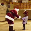 Ambreal Evans, 4, Ottumwa, gets a gift from Santa Clause at Indian Hills Community College Wednesday.
