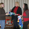 Sonja Ferrell, president of the High Noon Kiwanis, Sue Huff of Iowa Kids University and Melissa Rhoads of South Ottumwa Savings Bank prepare to surprise some special kids. Huff got help so the children in her program would have a merry Christmas. <br /> Mark Newman