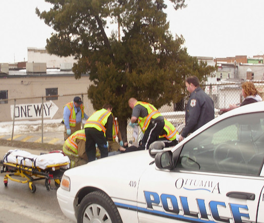 Police, fire and rescue workers assist a young person struck by a car down the street from Ottumwa High School. Due to the ages of those involved, names are not being released publically, but the victim appeared conscious and alert Wednesday afternoon.