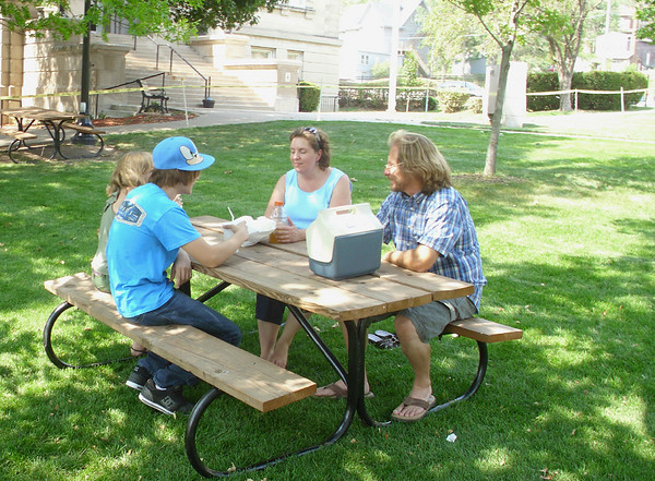 The Lanning family of the Troy, Mo. area make their traditional picnic stop at Central Park in Ottumwa even with temperatures hitting nearly 100 degrees. They and other people around the area found ways to have fun and keep cool Friday.