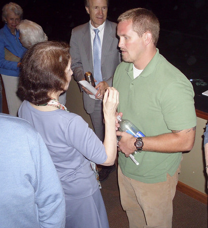 War veteran Luke Jensen from Nevada, Iowa, speaks with audience members after taking part in a presentation on post traumatic stress disorder Saturday in Fairfield. A civilian police officer and SWAT team member when his Army Reserve unit was deployed, Jensen thought he was too tough to suffer PTSD.
