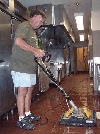 Mark Newman/The Courier<br /> Dave Riddle with the custodial staff gets up the grease from an entire school year of lunches at OHS. There are workers in the school buildings Monday through Friday; they have about 30 days to be ready to open.