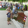 Cub Scout North Lindell of Pack 2, left and Boy Scout Levi Parks of Troop 2 assist Monday with the posting of the colors at the 10th Annual Declaration of Independence Celebration in Ottumwa's Central Park. The Wapello County Republicans hosted the event.