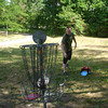 "Luke ""Condor"" Schleidt, an aviation student at Indian Hills, plays disc golf with a classmate at Wildwood Park on Sunday. The moderate weather saw multiple players at the park, as well as bicyclists, dog walkers and a dad shooting some hoops with his son. <br /> Mark Newman/The Courier"