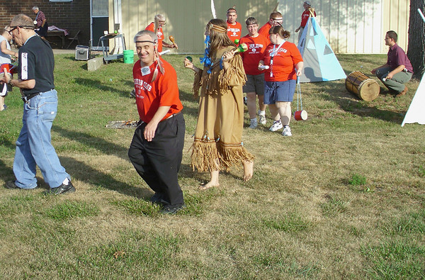 Mark Newman/Ottumwa Courier reporter<br /> Members of the Tenco Industries-based Aktion Club, sponsored by Ottumwa Kiwanis, learn a traditional rain dance in Ottumwa on Tuesday. The USDA calls the recent drought the worst in 25 years.