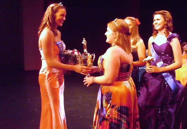Pageant officials chose Rachel Hinebaugh , left, as the 2012 Wapello County 4-H Expo Queen.