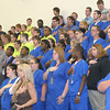 Mark Newman/The Courier<br /> Students in the uniforms of various job skill courses join with members of the public for the Pledge of Allegience Friday before seeing Presidential Cabinet member Hilda Solis, the U.S. Secretary of Labor.