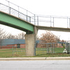 The Bridge, the Highway and the School By Mark Newman,<br /> Kids used to use this pedestrian bridge to get over the highway to Eisenhower Elementary School (background). The bridge probably won't be repaired during this school year.