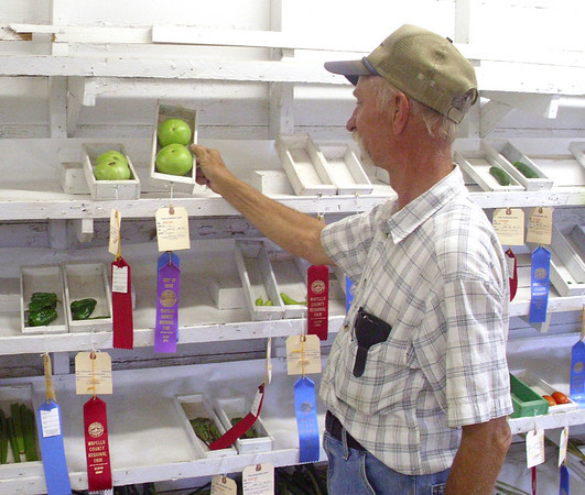 Don Harness of Eldon takes pride in the things he grows, so the Wapello County Fair is place to show off his hard work. The fair runs through Sunday.