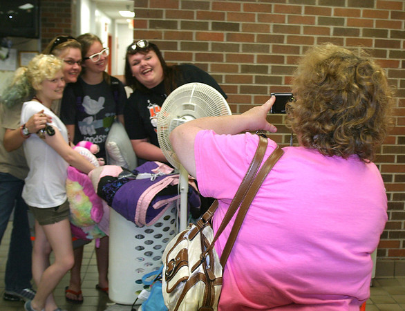 Parents like Debbie Baugher of Albia snapped pictures and helped get their Upward Bound students settled on the first day of the summer program Monday. The students, age 14-18, will be taking summer classes to help keep them on track for a college education.