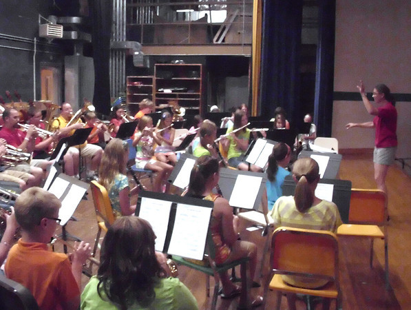 Pam DeBoer, Evans Middle School band instructor, allows kids to show off how far they've come over the past few weeks during a summer concert Wednesday.<br /> Mark