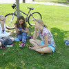 """Mark Newman/The Courier<br /> Even with four-year-old Hunter Beggs' blue Kool-Aid mustache, baby sitter Stephanie Turner, 16, left, with friends Miranda Readdy and Korrina Long, says he's easy to look after. The kids found a shady spot near Evans Middle School to text and hang out because it was """"too nice"""" to be inside Monday."""