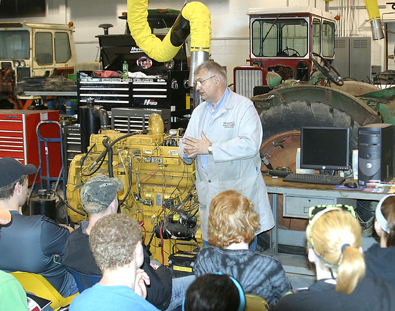 Mark Newman/The Courier<br /> Diesel Power Systems instructor Allan Ready talks to students about how important it is to keep learning in his profession. Juniors from high schools around the region paid a visit to Indian Hills Community College on Thursday.