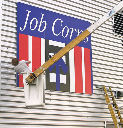 """The biggest sign on the Ottumwa Job Corps Center campus was erected Tuesday. The director said they can now give directions to the center ending with the phrase, """"You can't miss it.""""<br /> Mark Newman/The Courier"""