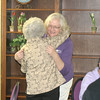 Medical social worker Jan Hisel gets a hug from a well wisher at Hospice Serving Davis and Wapelllo Counties in Ottumwa this week. She is retiring after 21 years.