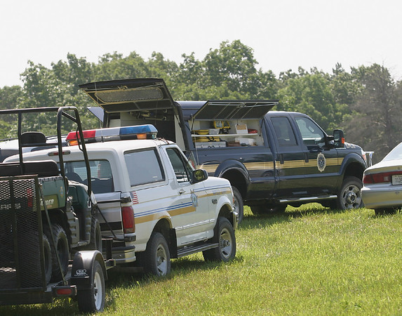 Mark Newman/The Courier<br /> A state forensics truck stands ready Sunday as DCI investigators work with local law enforcement to process the scene at a shooting in rural Wapello County near Agency.