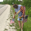 Gary Short does spends hours lining the roads in and out of Ottumwa with American flags on Friday. The tradition was started by his father.<br /> Mark