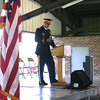 Lt. Col. Mark Coble pauses during a Memorial Day presentation at Ottumwa Park Monday morning.