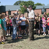 """Scientist Doug Helmers of the U.S. Fish and Wildlife Service teaches students at Eisenhower Elementary School how to do a prairie stomp in order to plant native wildflowers. The project is part of the agency's """"Partners for Fish and Wildlife"""" habitat restoration plan."""