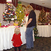 Mindy Young of Ottumwa watches Friday night as daughter Olivia Grace Young, 16 months, experiences the colors, movement and sounds of the annual Festival of Trees.