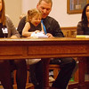 Laughter in the Court<br /> Mark Newman/The Courier<br /> Robert Bowman of Faifield holds daughter Hailey, 2, during the court proceding that made her adoption official.