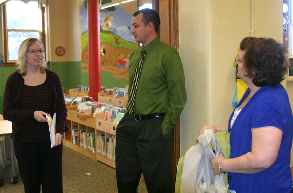 Ottumwa Public Library Director Sonja Ferrell, left, shows the juvenile book section to Dusty Stewart, vice-president of the High Noon Kiwanis and Teresa Sammons of the Morning Kiwanis. The two Kiwanis groups teamed up to deliver the $3,000 from their annual BBQ to benefit library programs for kids.