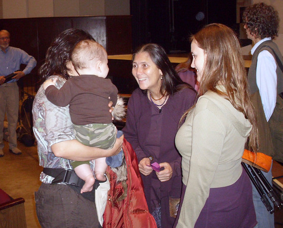 Robin Lim, a midwife, community activist and CNN Hero of the Year, meets one of her smallest fans at a Fairfield High School assembly for studens, staff and the public. To find the hero inside them, she said, students must do what they love.