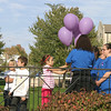 Members of the community gather to release purple balloons in Ottumwa to recognize the effort to end domestic violence. The Monday event by the Crisis Center and Women's Shelter provided information on where to turn for help.<br /> Mark